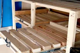 diy garage storage shelf with sliding drawers using gate handles