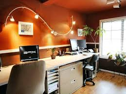 best lighting for office. home oofice with wall track lighting fixture over beige computer desk surrounded by brown interior best for office