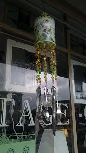and suspended beads and odd pieces of stainless flatware with fishing line to create this cute wind chime i love the salt shaker hanging in the center