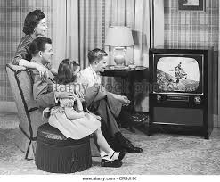 black family watching tv. family watching television - stock image black tv c