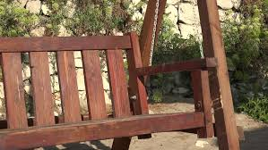4k rocker chair balancing in summer holiday in rural yard recreation wooden cradle