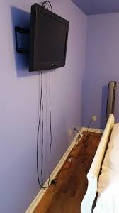 would there be any problems dropping the coax cable and the power cable behind the wall against the insulation