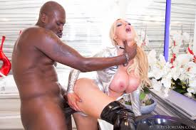 Black Nikki Benz with Big Tits Wearing Collar Giving Blowjob.