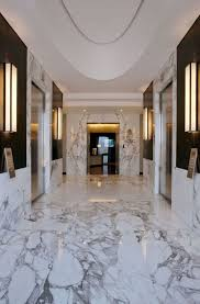 white marble tile floor and wall design for hallway