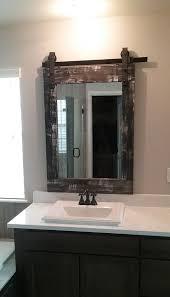 single bathroom mirror of barn wood with rustic finish