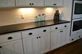 simple kitchen with black honey granite kitchen countertops oil rubbed bronze cabinet hardware bin cup