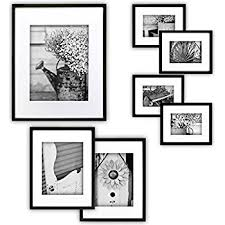 black picture frames. GALLERY PERFECT 7 Piece Black Photo Frame Wall Gallery Kit #11FW1443. Includes: Frames Picture T