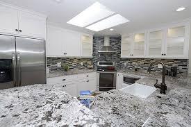 alaska white granite countertops with subway tile backsplash