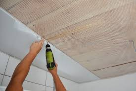 installing wall and ceiling panels in