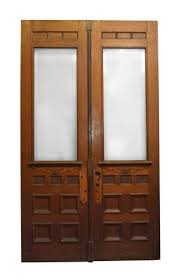 double carved wooden entry doors with beveled glass panels