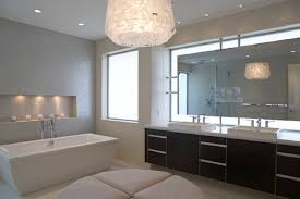 pendant modern bathroom lighting above round ottoman and freestanding bathtub also double sink bathroom vanity bathroom lighting ideas double vanity modern