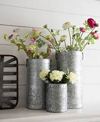 Fresh flowers look great in a galvanized vase! Would you put this on the  mantel