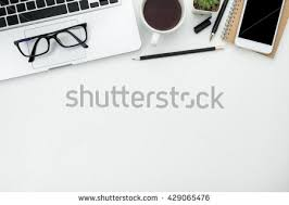 white table top view. White Office Desk Table With Laptop, Cup Of Coffee And Supplies. Top View