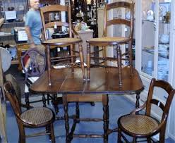 vine cane seat dining chairs 4 available c 1920 s chairs are solid wood construction with cane seats and slat backs excellent condition