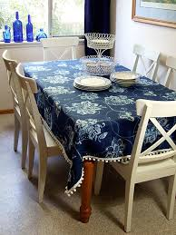 great idea add pompom trim to leftover fabric make a tablecloth table cloth