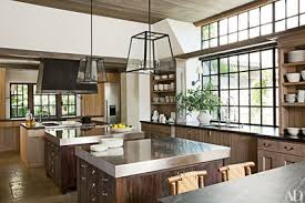 Island pendant lighting Amazing Kitchen Sconces From Urban Electric Co Illuminate The Sink Areas And Pendant Lights Designed By Rela Are Installed Over The Stainlesssteel Islands Architectural Digest 31 Kitchens With Pretty Pendant Lighting Architectural Digest