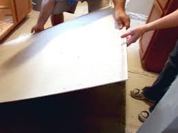 Laying Kitchen Floor Tiles How To Install A Tile Floor In A Kitchen How Tos Diy