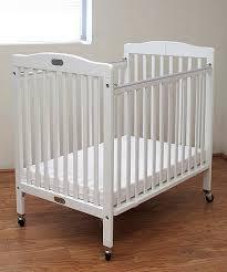 white the little wood folding portable crib