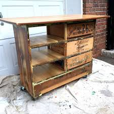 picture of ugly dresser turned into rustic kitchen island cart