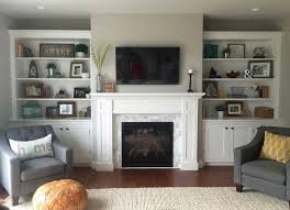 instructions to build this fireplace mantel with built in cabinets and bookshelves shaker style made out of solid poplar and birch plywood
