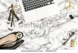 feminine office supplies. notebook shoes office supplies feminine business woman accessories on bright marble table background