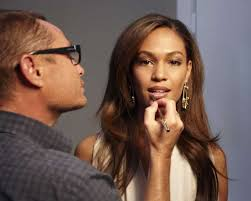 estée lauder creative makeup director tom pecheux applies finishing touches to the pany s first latina spokesmodel