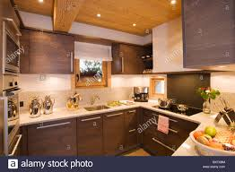 Kitchen down lighting Amazing Kitchen Small Modern Kitchen With Downlighting In Alpine Chalet Alamy Small Modern Kitchen With Downlighting In Alpine Chalet Stock Photo