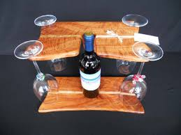 these self standing 4 4 wine glass holders are made with koa and mango or koa wood inlays it s a great way to display your favorite wine and holds up to