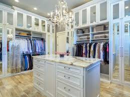 luxury walk in closet with chandelier in a high rise condo building in florida