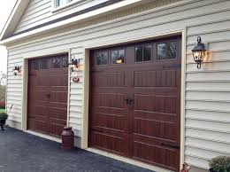 9x9 gallery collection in walnut 9x9 clopay gallery door walnut finish long panel rectangular grids hardware is clopay 14 handles and 18 hinges