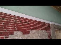 install crown moulding on brick wall