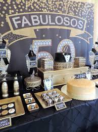 dessert table from a fabulous 50 black gold birthday party via kara s party ideas