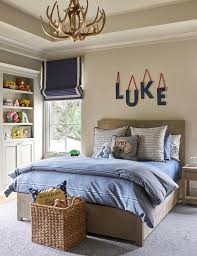 hanging blue letters over kids bed