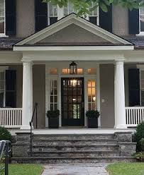 gray house white trim black door shutters by maritza