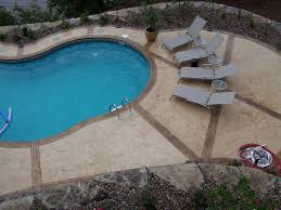 Stamped Concrete Pool Surrounds With Scenic Lake View