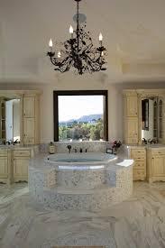 los angeles jacuzzi soaking tub with brown chandeliers bathroom mediterranean and chandelier custom cabinets