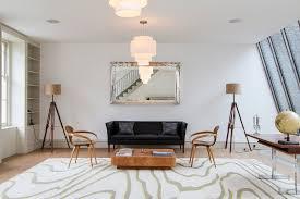modern classics living room midcentury with tripod floor lamp