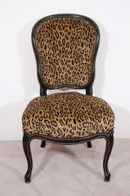 a pair of 19th century slipper chairs with ebonized frame brass beading and newly upholstered