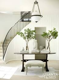 illuminating foyer chandelier and round table