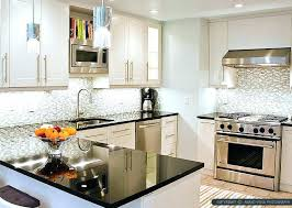 white kitchen cabinets and granite countertops dark granite white kitchen cabinets with dark granite off white