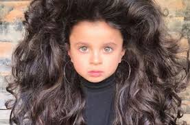 this 5 year old s big hair is going viral and her pas are being shamed for of it