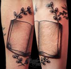 old book and laurel custom tattoo by miguel angel tattoo