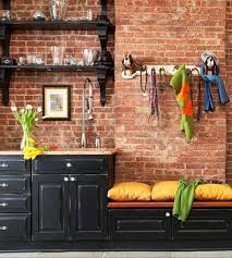 red bricks look especially well with black kitchen cabinets and shelves