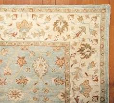 1 at the cool blues and tans in this wool rug will soften your space pottery barn rugs