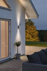 led up and down outdoor wall light offered in two stylish designs angular square and round sliced cylinder from lighting styles the specialist lighting