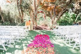 colorful ceremony with pink and orange san go botanic garden wedding in encinitas cavin