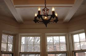 chandeliers that appear small from ground level can actually be large heavy fixtures