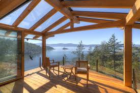 covered deck ideas. Roof Deck Ideas For Elegant Home Designs: Wood Furniture With Glass Covered And Cantilevered C
