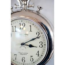 silver pocket watch wall clock by the