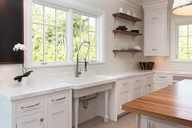 freestanding vintage kitchen sink under windows transitional
